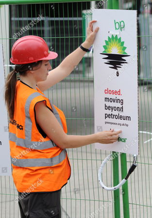 A Greenpeace Activist Placards a Closed Placard at a British Petroleum Petrol Station Closed Due to the Greenpeace Protest in Camden London 27 July 2010 Greenpeace Activists Say They Have Shut Down Every Bp Petrol Station in London Putting Up Signs Saying: 'Closed Moving Beyond Petroleum' Bp Has Confirmed Tony Hayward Will Step Down After the Company Posted Losses of ú11bn For the Second Quarter of the Year United Kingdom London