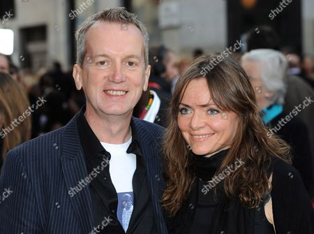 Stock Picture of British Comedian Frank Skinner (l) Arrives with and Unidentified Guest at the Uk Family Gala Premiere of 'Africa United' at the Odeon Leicester Square in London Britian 17 October 2010 the Movie by British Director Debs Gardner-paterson Tells the Story of Two Young Rwandan Boys Fabrice who Comes From a Privileged Background and Dudu who is From an Impoverished Neighborhood They Both Set out on a Long Journey Together to Make It to South Africa in Time For the Soccer World Cup United Kingdom London