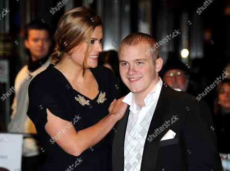 British Actor and Cast Member Conor Mccarron (r) Arrives with British Actress and Cast Member Marianna Palka (l) at the Premiere of 'Neds' During the 54th Bfi London Film Festival Held at the Vue West End in London Britain 20 October 2010 the Movie is a Feature Film on British Director Peter Mullan's Youth in 1970s Glasgow Scotland United Kingdom London