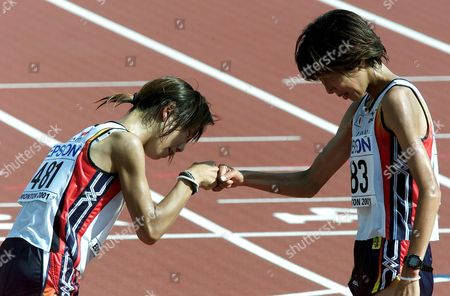 Edmonton Canada: Japanese Runners Yoko Shibui (left) and Reiko Tosa Congratulate Each Other After Finishing Womens Marathon at the World Athletics Championships in Edmonton Sunday 12 August 2001 Lidia Simon of Romania Won the Race Ahead of Reiko Tosa of Japan and Svetlana Zakharova of Russia Yoko Shibui Finished 4th