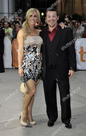 Stock Picture of Canadian Former Nhl Hockey Player Theo Fleury (r) Arrives with His Wife Jennifer For the Premiere of the Film 'Score a Hockey Musical' on the Opening Night of the 35th Annual Toronto International Film Festival in Toronto Canada on 09 September 2010 Canada Toronto