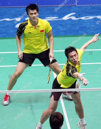 Cai Yun (r) and Fu Haifeng of China in Action During Their Submatch Against Jaesung Chung and Yongdae Lee of South Korea in the Men's Badminton Team Final at the 16th Asian Games in Guangzhou Southern China's Guangdong Province 15 November 2010 Chung and Lee Won 19-21 21-16 and 21-18 China Guangzhou