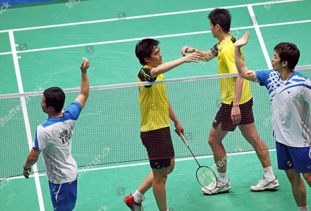 Jaesung Chung (r) and Yongdae Lee (l) of South Korea Are Congratulated by Cai Yun (2nd R) and Fu Haifeng of China at the End of Their Submatch in the Men's Team Final at the 16th Asian Games in Guangzhou Southern China's Guangdong Province 15 November 2010 Chung and Lee Won 19-21 21-16 and 21-18 China Guangzhou