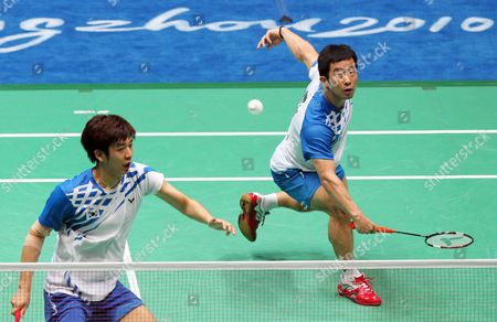 Jaesung Chung (r) and Yongdae Lee of South Korea in Action During Their Submatch Against Cai Yun and Fu Haifeng of China in the Men's Team Final at the 16th Asian Games in Guangzhou Southern China's Guangdong Province 15 November 2010 Chung and Lee Won 19-21 21-16 and 21-18 China Guangzhou