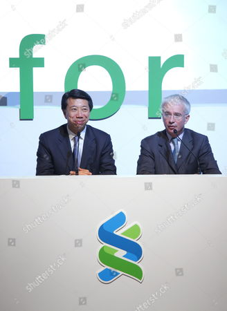 Peter Sands (r) Group Chief Executive Standard Chartered Plc and Benjamin Hung Ceo Standard Chartered Bank (hong Kong) Limited Attend a Press Conference where the Company Unveiled the Group's New Worldwide Brand Promise 'Here For Good' in Hong Kong China 29 April 2010 Standard Chartered 31 March Rolled out a Global Brand Campaign Focused on Its Commitment to Being a Positive Force in the Markets where It Operates Across Asia Africa and the Middle East the Bank Said 'The Campaign Will Help to Establish the Banks New Brand Promise Here For Good Underlining the Banks Distinctive Approach to International Banking and Creating a Strong Platform For Continued Growth ' China Hong Kong