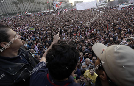 Egyptian Wael Ghonim (c Back to Camera and Pointing) a Google Inc Marketing Manager For Northern Africa and the Middle East Addresses a Crowd on Tahrir Square in Cairo Egypt As Thousands of Protestors Continued Their Anti-government Demonstrations on 08 February 2011 Ghorim who was Released From Police Custody on 08 February After Being Arrested on 28 January is Regarded As a Leading Force Behind the Internet Campaigns That Helped the Anti-mubarak Movement Gain Momentum Egypt Cairo