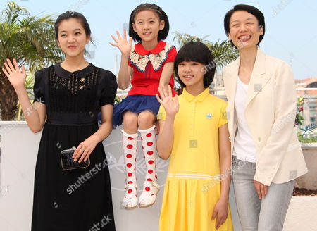 South Korean Director Ounie Lecomte (r) Poses with South Korean Actresses Ah Sung Ko (l) Sae Ron Kim (2ndl) and Do Yeon Park Pose During the Photocall of the Movie 'A Brand New Life' in the 62nd Edition of the Cannes Film Festival in Cannes France 19 May 2009