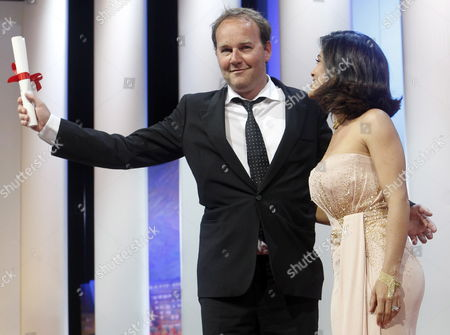 French Director Xavier Beauvois (l) Receives the Grand Prix Award For His Movie 'Des Hommes Et Des Dieux' (of God and Men) From Mexican Actress Salma Hayek (r) During the Closing Award Ceremony of the 63rd Cannes Film Festival in Cannes France 23 May 2010 the Award Ceremony is Followed by the Screening of 'The Tree' by French Director Julie Bertuccelli Presented out of Competition of the Cannes Film Festival 2010 France Cannes