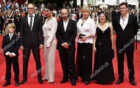Actors Victor Tremmel (r) Michael Fuith (c) Asutrian Director Markus Schleinzer (2-l) Actors David Rauchenberger (l) Ursula Strauss (3-l) Gisella Salcher (2-r) and Christine Kain (3-r) Arrive For the Screening of 'Michael' During the 64th Cannes Film Festival in Cannes France 14 May 2011 the Movie by Markus Schleinzer is Presented in the Official Competition of the Film Festival Running From 11 to 22 May France Cannes