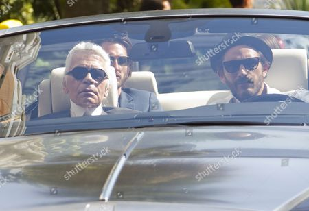 German Designer Karl Lagerfeld (l) Arrives by Car with French Model Sebastien Jondeau (r) at the Majestic Hotel Ahead of the 64th Cannes Film Festival in Cannes France 10 May 2011 the Film Festival Will Run From 11 to 22 May France Cannes