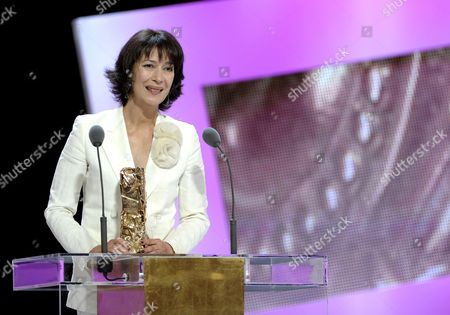 Stock Picture of French Actress Anne Alvaro Receives the Best Supporting Actress Award For Her Role in 'Le Bruit Des Glacons' During the 36th Cesar Awards Ceremony Held at the Chatelet Theatre in Paris France 25 February 2011 the 'Academie Des Arts Et Techniques Du Cinema' of France Honours Excellence in 21 Categories France Paris