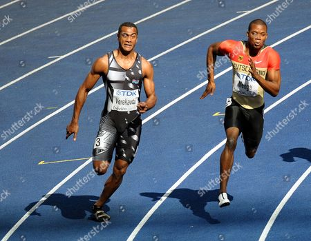 Stock Picture of Aleixo-platini Menga of Germany Competes in the 200m Heat 1st Round at the 12th Iaaf World Championships in Athletics Berlin Germany 18 August 2009 Left is Niko Verekauta of Fiji Germany Berlin