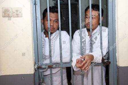Indonesian Terrorist Suspects Rohmat Puji Prabowo Alias Bejo (l) and Supono Stands Behind Bars As They Wait For Their Trial in Jakarta Indonesia on 22 June 2010 an Indonesian Court on Tuesday Sentenced Bejo to Seven Years in Prision For Concealing Information and Harboring Terrorists Linked with the July 17 Attacks at the J W Marriott and Ritz Carlton Hotels Indonesia Jakarta
