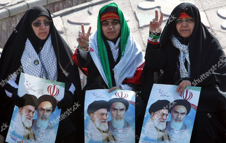 Iranian Women Flash Victory Sign As Hold Posters of Iran's Supreme Leader Ayatollah Ali Khamenei and the Late Supreme Leader of the 1979 Islamic Revolution Grand Ayatollah Ruhollah Khomeini As Thousands of Iranian Government Supporters Stage a Protest Demonstration Against Opposition Leaders on 18 February 2011 in Tehran Iran the Iranian Authorities Staged a Demonstration Against the Two Main Opposition Leaders More Than 200 Legislators Several Clerical Groups and Government Supporters Have Called For the Arrest and Execution of Mir-hossein Moussavi and Mehdi Karroubi For Allegedly Undermining the Islamic System and Collaborating with Foreigners Iran (islamic Republic Of) Tehran