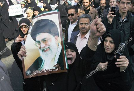 An Iranian Woman Shouting Slogans Holds a Poster of Iran's Supreme Leader Ayatollah Ali Khamenei As Thousands of Iranian Government Supporters Stage a Protest Demonstration Against Opposition Leaders on 18 February 2011 in Tehran Iran More Than 200 Legislators Several Clerical Groups and Government Supporters Have Called For the Arrest and Execution of Mir-hossein Moussavi and Mehdi Karroubi For Allegedly Undermining the Islamic System and Collaborating with Foreigners Thousands of Government Supporters Gathered After Friday Prayers in Enqelab Square in Central Tehran and Took Up the Call Shouting 'Moussavi and Karroubi Should Be Hanged ' Iran (islamic Republic Of) Tehran