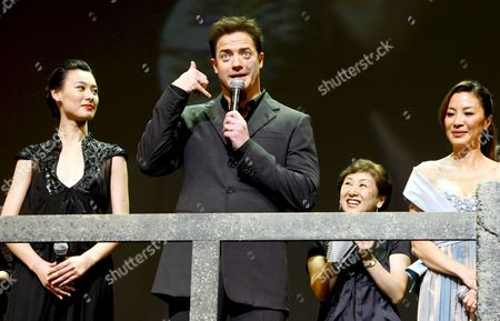 Us Actor and Cast Member of the Us Film 'The Mummy: Tomb of the Dragon Emperor' Brendan Fraser (c) Reacts While Chinese Actress and Cast Member Isabella Leong (l) and Malaysian Actress and Cast Member Michelle Yeoh (r) Look on During the Japan Premiere in Tokyo Japan 04 August 2008 Directed by Us Director Rob Cohen the Third in a Series of Box Office Hits the Latest Movie Tells the Story of Adventurer Rick O'connell (fraser) who Combats the Resurrected Han Emperor (jet Li) in an Epic That Races From the Catacombs of Ancient China High Into the Frigid Himalayas the Movie Will Hit the Cinemas All Over Japan on 16 August 2008 Japan Tokyo