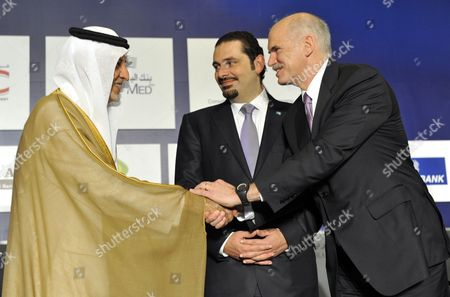 Lebanese Prime Minister Saad Hariri (c) Looks on While the Saudi Prince Khaled Al-faisal Bin Abdul Aziz Al-saud Governor of Mecca (l) Shake Hands with Greek Prime Minister George Papandreou (r) During the Opening Session of the 18th Arab Economic Forum in Beirut Lebanon 20 May 2010 Lebanon Beirut