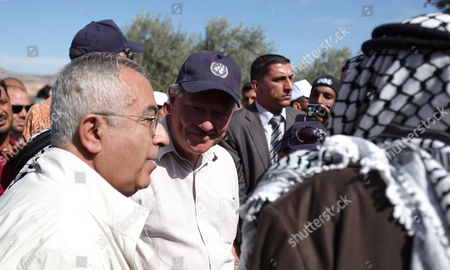 Palestinian Prime Minister Salam Fayyad (l) and the Un Special Coordinator For the Middle East Pease Process Robert H Serry (c) Talk to Palestinian Farmers in the West Bank Village of Turmus Ayya on 26 October 2010 to Mark the Un Day by Participating in the Olive Harvest - Turmus Ayya