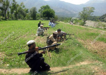 Stock Picture of Pakistani Tribal Militia Take Position at Bajaur Tribal Region Near the Afghan Border in Pakistan on 12 July 2011 Pakistan's Defence Minister Threatened to Pull Back Troops From the Afghan Border in Reaction to the Suspension of Military Assistance by the United States a Report Said the Express Tribune on 12 July Quoted Defence Minister Ahmad Mukhtar Saying That Pakistan Would Withdraw Troops From Nearly 1 100 Security Posts Near the Afghan Border if the Aid Were Suspended William Daley the White House Chief of Staff Said on 10 July That the Us Had Difficult Relations with Pakistan and Until 'We Get Through These Difficulties' Washington Would Hold Back Around 800 Million Dollars of Military Aid to Pakistan the Minister Said 300 Million Dollars of the Proposed Aid Pays For Deployment of Troops in the Troubled Tribal Areas Along the Border Pakistan Bajaur
