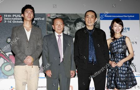 (l-r) Chinese Actor Shawn Dou South Korean Festival Director Kim Dong-ho Chinese Director Zhang Yimou and Chinese Actress Zhou Dongyu Pose For a Photograph After a Press Conference to Present the Opening Film 'Under the Hawthorne Tree' of the 15th Pusan International Film Festival (piff) in Busan South Korea 07 October 2010 the Biggest Film Festival in Asia Showcases 308 Films From 67 Countries From 07 to 15 October in Busan Korea, Republic of Busan