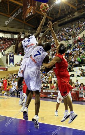 France' Ian Mahinmi (l) and Alain Koffi (c) Vie For the Ball with Spain's Ricky Rubio (r) During Their Fiba World Basketball Championship Preliminary Round Match at Halkapinar Arena in Izmir Turkey 28 August 2010 Turkey Izmir