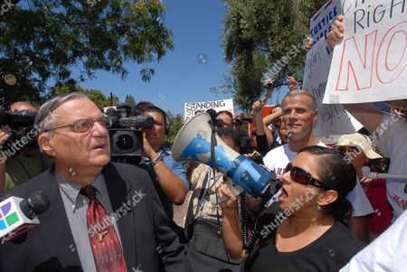 Joseph Arpaio Sheriff of Maricopa County in Arizona Looks Up at a Sign Being Held by Protestors Outside a Country Club where He Will Give a Presentation For a Meeting of the Conservative Order of Good Government on 8 August 2010 in San Diego California Usa Arpaio Has Drawn Much Attention For His Hard Line Law Enforcement Style and His Support of Local Enforcement of Federal Immigration Laws About 120 Protestors Turned out Against Arpaio United States San Diego