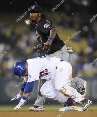New York Mets Shortstop Jose Reyes (back) Attempts the Double Play As Los Angeles Dodgers' Russell Martin (front) is Safe at Second As Los Angeles Dodgers' Garret Anderson is out at First During Ninth Inning of a Major League Baseball Game in Los Angeles California Usa 22 July 2010 the Dodgers Won 2-0 United States Los Angeles