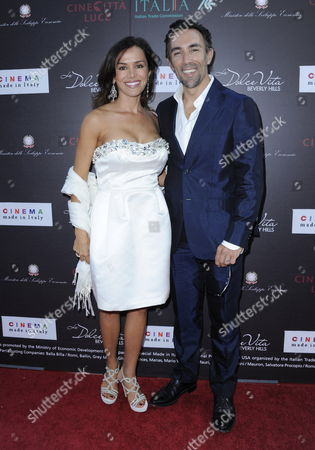Stock Image of Italian Born Us Raised Actor Francesco Quinn (r) and Valentina Castellani (l) Arrive For a Screening of the Film 'Nessuno Mi Puo Giudicare' (escort in Love) in Beverly Hills California Usa 24 June 2011 Cinecittv Luce the Italian Institution For the Promotion and Preservation of Italian Cinema Worldwide Hosted the Premiere Screening of the Film Directed by Massimiliano the Film Recently Won Three David Di Donatello Awards the Highest Honors Presented by the Italian Film Industry the Movie Chronicles the Life of a 35-year-old Woman Whose Life Seems to Have a Silver Lining Until Her Husband Dies in an Accident and She Finds Herself Reduced to Poverty Her Only Way out is to Turn to the Oldest Profession in the World United States Beverly Hills