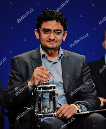 Stock Photo of Wael Ghonim of Egypt Holds the Profile in Courage Award Following His Speech and Acceptance of the Award For Himself and the People of the Country of Egypt For His Part in the Start the People's Revolution in Egypt at the John F Kennedy Library in Boston Massachusetts Usa 23 May 2011 United States Boston
