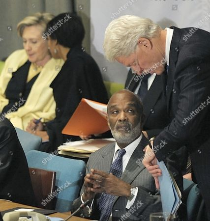 Haiti's President Rene Garcia Preval (seated) Speaks to Former Us President Bill Clinton (r) During the International Donor's Conference For Haiti at the United Nations Headquarters in New York Usa 31 March 2010 United States New York