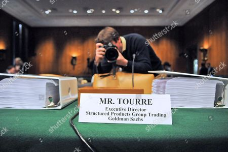 News Photographers Takes Pictures of a Folder with Documents Which is Placed on the Witness Table where Daniel L Sparks Former Partner Head of Mortgages Department the Goldman Sachs Group Inc Joshua S Birnbaum Former Managing Director Structured Products Group Trading at the Goldman Sachs Group Inc Michael J Swenson Managing Director Structured Products Group Trading at the Goldman Sachs Group Inc and Fabrice P Tourre Executive Director Structured Products Group Trading at the Goldman Sachs Group Inc Will Testify Before the U S Senate Permanent Subcommittee on Investigations During a Hearing on 'Wall Street and the Financial Crisis: the Role of Investment Banks ' on Capitol Hill in Washington 27 April 2007 the Hearing Focuses on the Role of Investment Banks in the Securitization of Residential Mortgage Related Products United States Washington