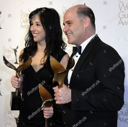 Stock Picture of Us Screenwriters Erin Levy (l) and Matthew Weiner (r) Hold Their Awards For Outstanding Drama Series and Episodic Drama For 'Mad Men' at the Writers Guild of America Awards (wga) in Hollywood California Usa 05 February 2011 United States Hollywood