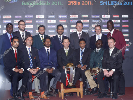 Icc World Cup 2011 Cricket Playing Captains (back Row L-r) Zimbabwe's Elton Chigumbura New Zealand's Daniel Vettori Pakistan's Shahid Afridi India's Mahendra Singh Dhoni South Africa's Graeme Smith England's Andrew Strauss West Indies' Darren Sammy; (front Row L-r) Canada's Ashish Bagai Dutch Peter Borren Sri Lanka's Kumar Sangakkara Australia's Ricky Ponting Bangladesh's Shakib Al Hasan Kenya's Jimmy Kamande and Ireland's William Porterfield Pose For Photographers with the Icc Wc2011 Trophy During a Press Conference at Sheraton Hotel in Dhaka Bangladesh 17 February 2011 the Opening Ceremony of the 10th World Cup Cricket Launched in Bangladesh with the Joint Hosts of the 14-team Competition Along with India and Sri Lanka Bangladesh Dhaka