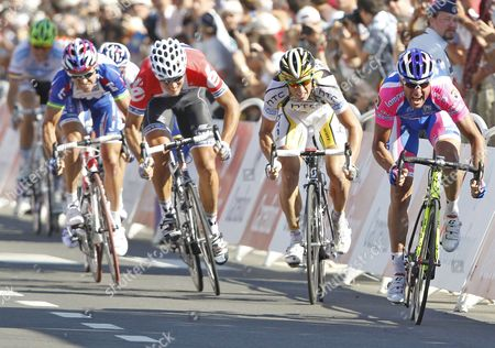 Lampre Team Rider Alessandro Petacchi of Italy (r) Sprints Ahead of Mark Renshaw of Australia (2nd R) Cervelo Team Rider Thor Hushovd of Norway (2nd L) and Katusha Team Rider Robbie Mcewen of Australia (l) to Win the First Stage of the 97th Tour De France 2010 Cycling Race Between Rotterdam in the Netherlands and Brussels in Belgium 04 July 2010 Belgium Brussels