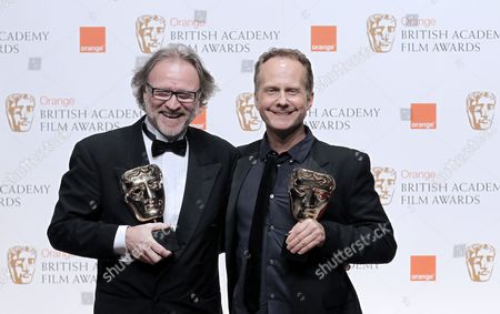 Danish Producer Soren Staermose (l) and Danish Director Niels Arden Oplev (r) Pose After Winning the Film not in English Language Award For Their Movie the Girl with the Dragon Tattoo at the Winners' Board During the 2011 Orange British Academy Film Awards (bafta) Held at the Royal Opera House in London Britain 13 February 2011 United Kingdom London