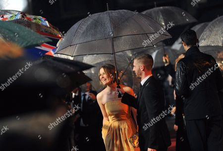 Stock Picture of New Zealand Actress/cast Member Carolyn Dando Gives Interviews Under an Umbrella As She Arrives For the Cinema and Television Benevolent Fund Royal Film Performance 2009: 'The Lovely Bones' Held at the Odeon Leicester Square in Central London Britian 24 November 2009 the Event is an Annual Charity Screening of the Current Year's Chosen Film Based On Alice Sebold's Bestselling Novel the Film by New Zealand Director Peter Jackson Also Stars Rachel Weisz Mark Wahlberg and Stanley Tucci the Plot Follows a Young Girl Who is Brutally Raped and Murdered and Then Observes the Effects of Her Death On Her Family From Heaven