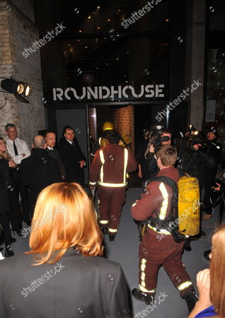 Fire Crews Enter the Venue when a Small Fire Disrupts the 'Love Ball' Charity Fundraiser Night Held at the Roundhouse in London Britain 23 February 2010 Russian Model Natalia Vodianova and Harper's Bazaar Editor Lucy Yeomans Host Fundraiser in Aid of Vodianova's Charity the Naked Heart Foundation Raising Money to Build Playgrounds For Children in Her Home Country As Well As Uk Children's Charities the Venue is Transformed Into an Adult Fairground Under the Creative Direction of British Designer Dinos Chapman the Evening Also Includes an Auction of Commissioned Works From Artists Including Jeff Koons Francesco Vezzoli Goscha Ostretsov and Marc Quinn United Kingdom London