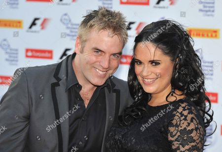 Stock Picture of British Television Show Host Donal Mcintyre (l) Arrives with an Unidentified Guest (r) at the F1 Party Held at the Natural History Museum in West London Britain 06 July 2011 the Party Precedes the Santander British Grand Prix Which Takes Place Between July 08 and July 10 in Silverstone England United Kingdom London