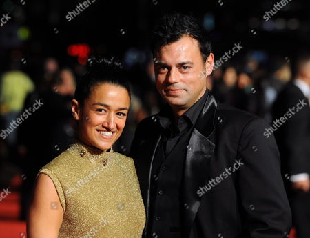 Stock Photo of Norwegian Actor and Cast Member Emil Marwa (r) Arrives with British Actress and Cast Member Zita Sattar (l) at the Premiere of British Director Andy De Emmony's Movie 'West is West' During the 54th Bfi London Film Festival Held at the Vue West End in London Britain 19 October 2010 United Kingdom London