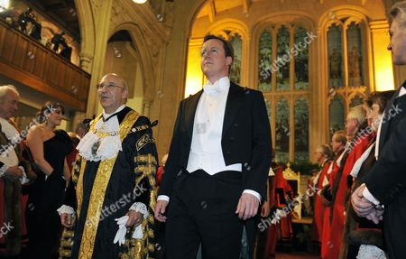 British Prime Minister David Cameron (r) is Pictured at the Lord Mayors Banquet with the Lord Mayor of the City of London Michael Bear in London Britain 15 November 2010 in a Major Foreign Policy Speech at the Lord Mayor's Banquet in London Cameron Rejected the Idea That the Rise of New Economic Powers Means Britain is 'Shuffling Apologetically Off the World Stage ' 'Britain Can Remain a World Power Despite the Emergence of New Economic Titans Like China But Only if It Sorts out Its Economic Problems' Prime Minister David Cameron Said United Kingdom London