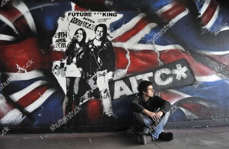 Street Artist Rich Simmons with His Mural of Prince William and Kate Middleton Depicted As Sid Vicious Bassist of the Seminal Punk Rock Band the Sex Pistols and His Girlfriend Nancy Spungen at the Southbank in London Britain 10 February 2011 Prince William and Kate Middleton Are to Marry at Westminster Abbey on 29 April 2011 United Kingdom London