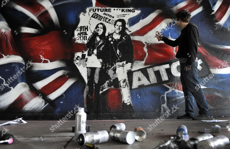 Street Artist Rich Simmons Puts the Finishing Touches to His Mural of Prince William and Kate Middleton Depicted As Sid Vicious Bassist of the Seminal Punk Rock Band the Sex Pistols and His Girlfriend Nancy Spungen at the Southbank in London Britain 10 February 2011 Prince William and Kate Middleton Are to Marry at Westminster Abbey on 29 April 2011 United Kingdom London