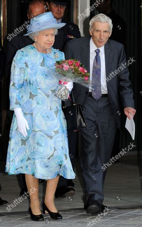 Britain's Queen Elizabeth Ii (l) Leaves the Royal Society's 350th Anniversary Convocation in the Company of Royal Society President Martin Rees (r) Held at the Royal Festival Hall in South London Britain 23 June 2010 the Royal Society is the National Academy of Science of the Uk and the Commonwealth It Supports Young Scientists Engineers and Technologists Influences Science Policy and Debates Scientific Issues with the Public It is an Independent Charitable Body Which Derives Its Authoritative Status From Over 1400 Fellows and Foreign Members United Kingdom London