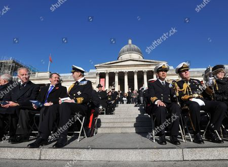 (l-r) Admiral Sir Peter Abbott British Defense Secretary Liam Fox Vice Admiral Sir Tom Blackburn Captain Mark Windsor Admiral Sir Mark Stanhope and Lady Srtanhope Watch the Festivities on Central London's Trafalgar Square During the Trafalgar Day Parade Britain 24 October 2010 the Parade Celebrates Admiral Nelson's Great Naval Victory on 21 October 1805 the Annual Event was Attended by 300 Sea Cadets and Dignitaries Including Senior Naval Officers the Lord Mayor of Westminster Mps and Admirals It Concluded with a Reading of Nelson's Prayer United Kingdom London