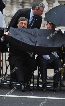 British Defense Secretary Bob Ainsworth (l) Struggles with His Umbrella During the Victory in Europe Day (ve Day) Commemorations Held at the Cenotaph Memorial in Central London Britain 8 May 2010 War Veterans Were Joined by Members of the Public Politicians and Royalty when the Nation Remembered the Unconditional Surrender of Nazi Germany in May 1945 Which Has Marked the End of World War Ii in Europe United Kingdom London