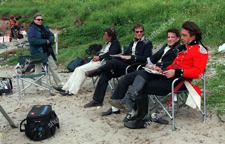 'Hornblower'   TV   Series 3 Picture Shows: Ioan Gruffudd (Hornblower), Greg Wise (Cotard), Christian Coulson (Young Hammond) and Sean Gilder (Styles) Taking a Break During Filming.