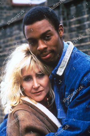 'London's Burning   TV Series 1 1988 Picture shows - Treva Etienne as Tony Sanders and Carol [Carole] Carole Harrison as Dorothy