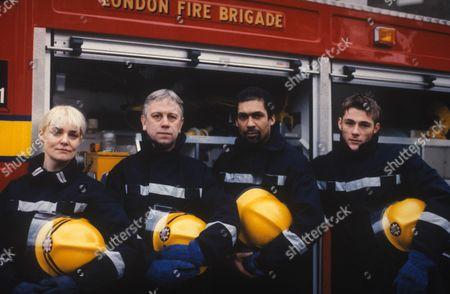'London's Burning   TV Series 10 1997 Picture shows - Zoe Heyes as Carole Webb, Michael Garner as Geoffrey 'Poison' Pearce, Ben Onwukwe as Stuart 'Recall' McKenzie and Steven Stephen Houghton as Gregg Blake.