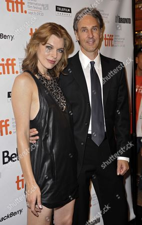 Ukrainian Actress Milla Jovovich (l) and Us Writer Angus Maclachlan Attend the Premiere of the Movie Stone Held at the Winter Garden Theater During the 35th Annual Toronto International Film Festival in Toronto Canada on 10 September 2010 the International Film Festival Runs 09 to 19 September 2010 Canada Toronto