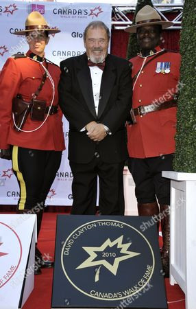 Stock Image of British-born Canadian Musician David Clayton-thomas (c) Formerly of the Band 'Blood Sweat & Tears' Poses with His Sidewalk Star at the 13th Annual Canada's Walk of Fame Ceremony in Toronto Canada on 16 October 2010 the Walk of Fame Honors Those who Have Excelled in the Arts Entertainment Sport and Science Canada Toronto